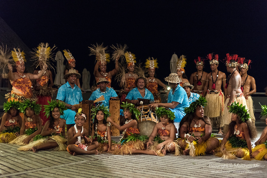 Rangiroa Atoll, Tuamotu Archipelago, French Polynesia; traditional Polynesian dancers perform for tourists after dinner