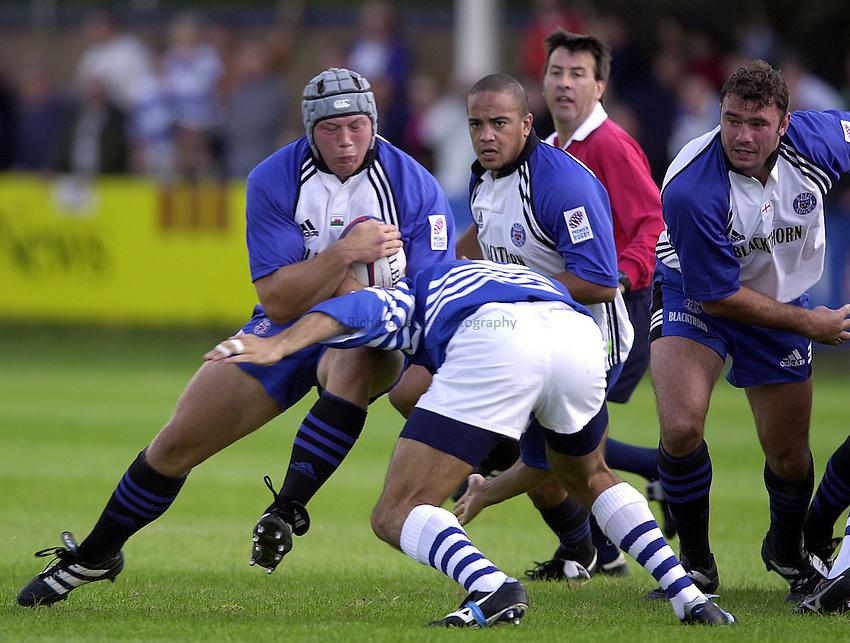 Photo. Richard Lane. .Sale v Bath. 19/8/2000. Zurich Premiership..Nathan Thomas hits Sale captain, Alex Sanderson.