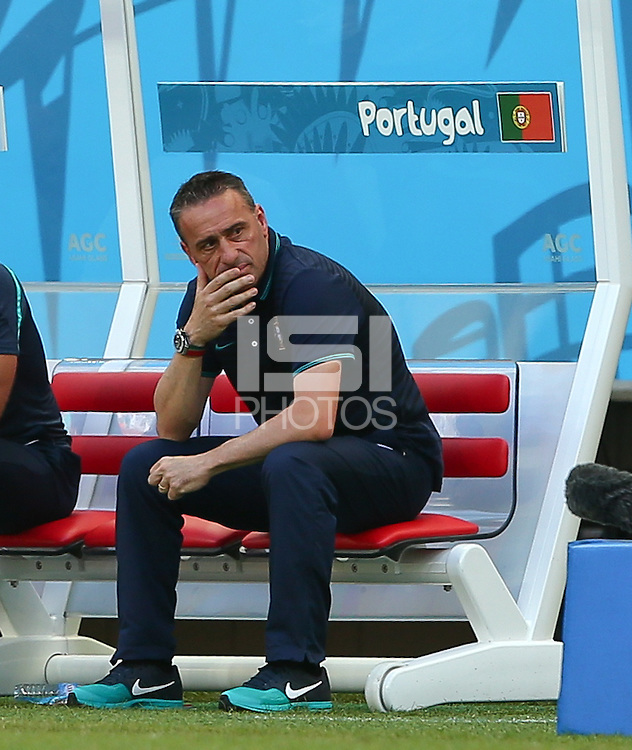 Portgual coach Paulo Bento shows a look of dejection in the dugout