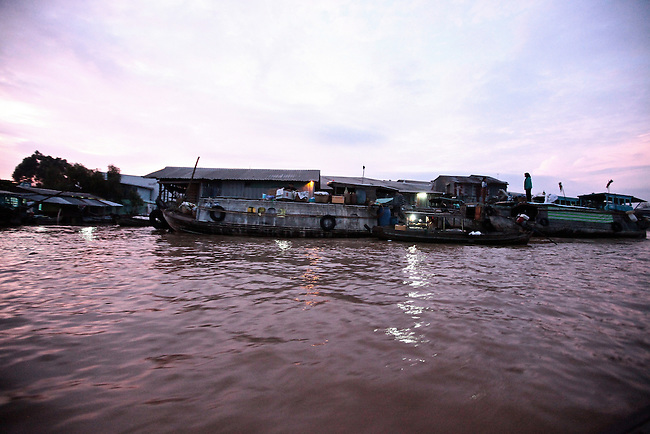 The sun rises over the Hau River in the Mekong Delta, south of Can Tho, Vietnam. Sept. 30, 2011.