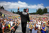 Aug. 4, 2013; Kent, WA, USA: NHRA top fuel dragster driver Shawn Langdon greets the fans during driver introductions prior to the Northwest Nationals at Pacific Raceways. Mandatory Credit: Mark J. Rebilas-USA TODAY Sports