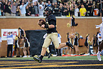 John Wolford (10) of the Wake Forest Demon Deacons scores a touchdown on a 2-yard run during first half action against the Presbyterian Blue Hose at BB&T Field on August 31, 2017 in Winston-Salem, North Carolina.  The Demon Deacons defeated the Blue Hose 51-7.  (Brian Westerholt/Sports On Film)