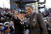 United States President Barack Obama has his picture taken with a member of the U.S. Navy on the flight deck of the USS Carl Vinson, docked at North Island Naval Station in San Diego, California, November 11, 2011. .Mandatory Credit: Pete Souza - White House via CNP