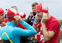 10 AUG 2014 - LIVERPOOL, GBR - Team Liverpool MPs team member Shadow Secretary of State for Health Andy Burnham (right) talks with other competitors before the start of the Tri Liverpool triathlon relay in Kings Dock in Liverpool, Great Britain. Burnham finished the swim leg in 20:50, with Steve Rotherham completing the bike in 48:26 and Luciana Berger finishing off with a 35:45 run (PHOTO COPYRIGHT © 2014 NIGEL FARROW, ALL RIGHTS RESERVED)