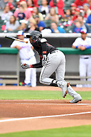 Birmingham Barons center fielder Luis Robert (26) runs to first base during a game against the Tennessee Smokies at Smokies Stadium on May 15, 2019 in Kodak, Tennessee. The Smokies defeated the Barons 7-3. (Tony Farlow/Four Seam Images)
