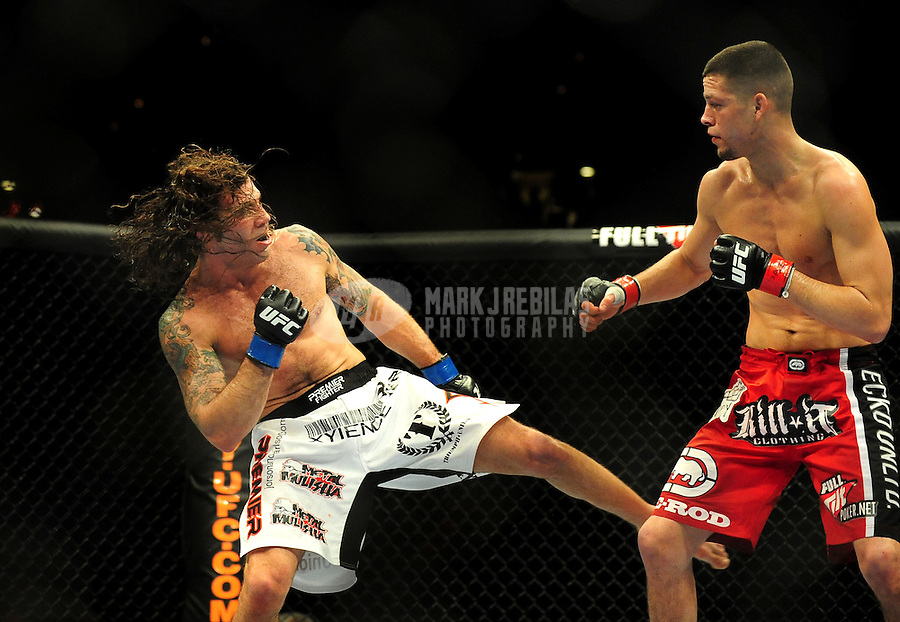 Jan. 31, 2009; Las Vegas, NV, USA; UFC fighter Clay Guida (white trunks) kicks Nate Diaz (red trunks) during the lightweight bout in UFC 94 at the MGM Grand Hotel and Casino. Guida defeated Diaz on a split decision. Mandatory Credit: Mark J. Rebilas-