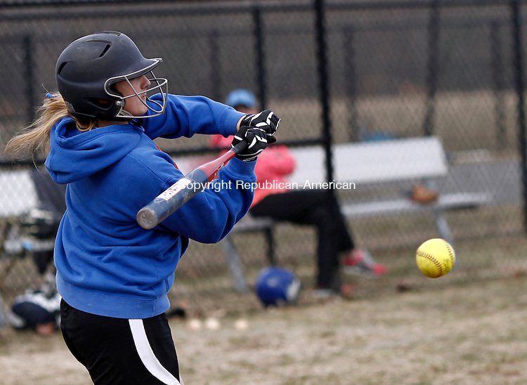Oxford, CT- 01 April 2014-040114CM08- Oxford High School softball captain Ashley Guillette takes swing during batting practice on Tuesday.   Christopher Massa Republican-American