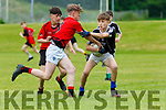 Eric McMahon Tralee District and Rian Colleran East Kerry in action in Killarney on Sunday
