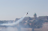 Lajos Imreh flying a Mi-2 helicopter performs in front of the Castle of Buda above River Danube during an Air show that celebrates Hungarian national holiday on the anniversary of state foundation in Budapest, Hungary  on Aug. 20, 2018. ATTILA VOLGYI