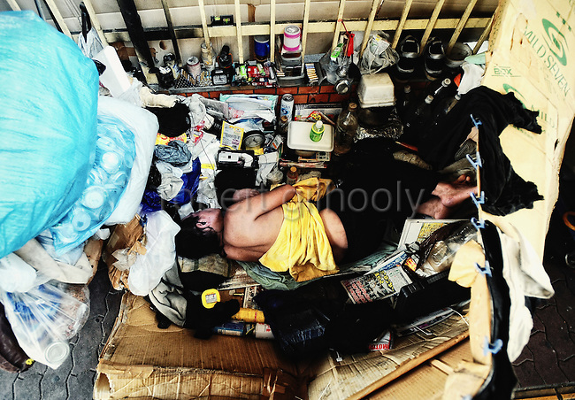 A homeless man makes camp under a flyover in downtown Osaka, Japan. According to official statistics, around 25 percent of Japan's estimated 24,000 homeless are located in Osaka, though in 2000 an independent survey put the number of homeless in the city at 15,000 -- three times the number of homeless in Tokyo.