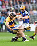 John Conlon of Clare in action against Donagh Maher of Tipperary during their quarter final at Pairc Ui Chaoimh. Photograph by John Kelly.