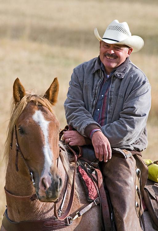Closeup portrait of cowboy and horse