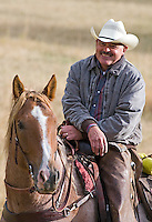 Closeup portrait of cowboy and horse