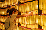 A visitor takes pictures of lanterns during the annual ''Mitama Festival'' at Yasukuni Shrine on July, 13, 2017, Tokyo, Japan. Over 30,000 lanterns are displayed along the entrance of the shrine to help spirits find their way during the annual celebration for the spirits of ancestors. The festival runs until July 16th. (Photo by Rodrigo Reyes Marin/AFLO)