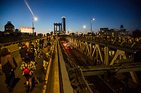 NEW YORK, NEW YORK - MAY 31: Protesters walk across the Manhattan Bridge on May 31, 2020 in New York. Protests spread across the country in at least 30 cities in the United States. USA For the death of unarmed black man George Floyd at the hands of a police officer, this is the latest death in a series of police deaths of black Americans (Photo by Pablo Monsalve / VIEWpress via Getty Images)
