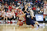 SIOUX FALLS, SD - MARCH 8: Madison McKeever #23 of South Dakota and Jentry Holt #41 of Oral Roberts battle for a loose ball at the 2020 Summit League Basketball Championship in Sioux Falls, SD. (Photo by Richard Carlson/Inertia)