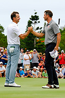 Wade Ormsby (AUS) congratulates Adam Scott (AUS) as he wins on the 18th green during round 4 of the Australian PGA Championship at  RACV Royal Pines Resort, Gold Coast, Queensland, Australia. 22/12/2019.<br /> Picture TJ Caffrey / Golffile.ie<br /> <br /> All photo usage must carry mandatory copyright credit (© Golffile   TJ Caffrey)