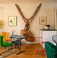In the corner of the living room the owner has created a music area with designer chairs and instruments whilst the walls are decorated with an impressive collection of contemporary art