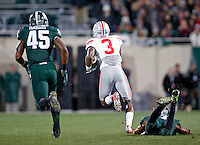 Ohio State Buckeyes wide receiver Michael Thomas (3) gets past Michigan State Spartans cornerback Darian Hicks (2) on a catch to score a touchdown during the 2nd quarter at Spartan Stadium in East Lansing, Michigan on November 8, 2014.  (Dispatch photo by Kyle Robertson)