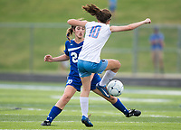 NWA Democrat-Gazette/CHARLIE KAIJO Rogers High School midfielder Grace Carrol (20) and Southside High School midfielder Rachel Smith (10) fight for possession of the ball during the semifinals of the 7A Girls State Soccer Tournament, Saturday, May 12, 2018 at Whitey Smith Stadium at Rogers High School in Rogers. Rogers advanced to the finals when midfielder Skylurr Patrick (3) scored both of Rogers' goals defeating Southside High School, 2-1.