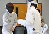 Matthew Ko of Great Neck South, left, battles Calum Gribbin of Garden City in an epee bout during a fencing meet at Garden City High School on Saturday, Jan. 9, 2016. Ko won the bout 5-1.