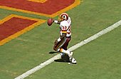 Washington Redskins running back George Rogers (38) celebrates as he carries the ball across the goal line for his team's second touchdown during the first quarter of game against the Houston Oilers at RFK Stadium in Washington, DC on September 16, 1985.   Rogers ran for 31 yards and a touchdown on the play.  The Redskins won the game 16 - 13.<br /> Credit: Howard L. Sachs / CNP