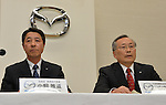 May 9, 2013, Tokyo, Japan - Outgoing President Takashi Yamanouchi, right, of Japan's Mazda Motor Corp., speaks during a news conference in Tokyo on Thursday, May 9, 2013. Masamichi Kogai, a production and purchasing specialist of the automaker, replaces Yamanouchi, who led Mazda to its first annual profit in five years. (Photo by Natsuki Sakai/AFLO)