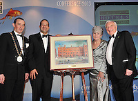 Michael Vaughan, President, IHF, presents a painting of The Merrion Hotel to Martin and Carmel Naughton, Entrepreneur, part owner of the hotel and founder of Glen Dimplex at the IHF annual banquet in The Malton Hotel, Killarney with Minister for Tourism Leo Varadakar, second left.  Mr. Naughton received the president's honour for his contribution to Irish business...Picture by Don MacMonagle..