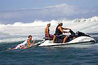 Andy Irons (HAW), Rainos Hayes (HAW) and Kiaborg (HAW) at Teahupoo, Tahiti. Photo: joliphotos.com