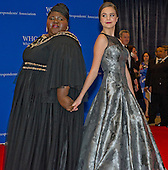 Gabourey Sidibe, left, and Bailee Madison arrive for the 2015 White House Correspondents Association Annual Dinner at the Washington Hilton Hotel on Saturday, April 25, 2015.<br /> Credit: Ron Sachs / CNP