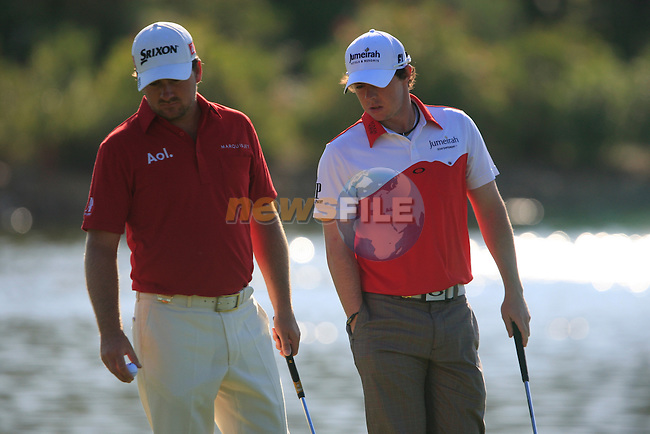 Rory McIlroy and Graeme McDowell (N.IRL) on the 4th green during the morning session on Day 3 of the Volvo World Match Play Championship in Finca Cortesin, Casares, Spain, 21st May 2011. (Photo Eoin Clarke/Golffile 2011)
