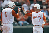 Texas Longhorns outfielder Mark Payton #2 is greeted by teammate Alex Silver #11 after he scores during the NCAA baseball game against the Texas A&M Aggies on April 28, 2012 at UFCU Disch-Falk Field in Austin, Texas. The Aggies beat the Longhorns 12-4. (Andrew Woolley / Four Seam Images).