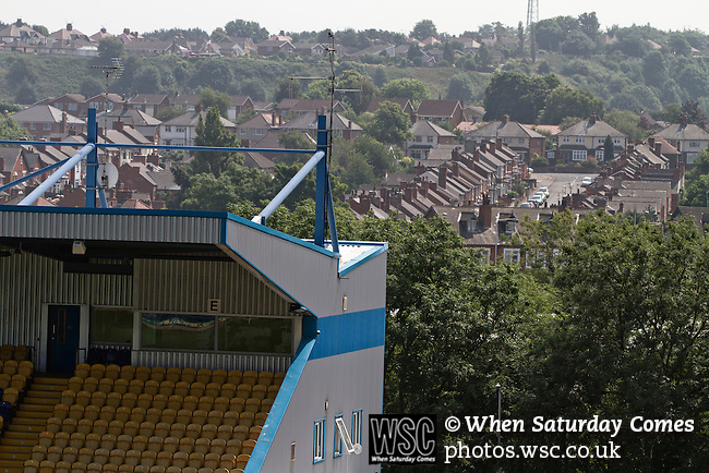 Mansfield Town Football Club Open Day, 14/07/2013. Field Mill stadium, League Two. Rows of traditional terraced houses situated behind one of the stands at Mansfield Town's Field Mill stadium during an open day held for the club's supporters. Mansfield Town achieved promotion back to England's Football League by winning the Conference National in season 2012-13. Field Mill was the oldest ground in the Football League, hosting football since 1861 although some reports date it back as far as 1850, with Mansfield Town having played there since 1919. Photo by Colin McPherson.
