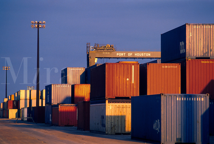 Cargo containers stacked at a shipping terminal.