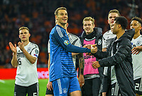 Torwart Manuel Neuer (Deutschland Germany) klatscht nach dem Spiel mit Serge Gnabry (Deutschland Germany) ab - 24.03.2019: Niederlande vs. Deutschland, EM-Qualifikation, Amsterdam Arena, DISCLAIMER: DFB regulations prohibit any use of photographs as image sequences and/or quasi-video.