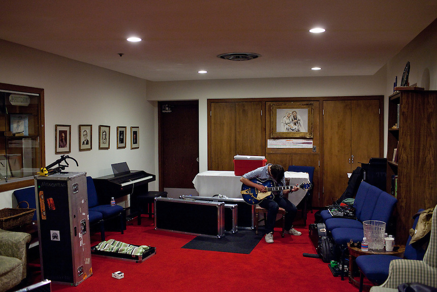 Sondre Lerche rehearses by himself in the green room of Central Presbytarian Church in Austin, Texas during the 2011 SXSW Music Festival.