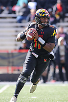 College Park, MD - November 3, 2018:  Maryland Terrapins quarterback Kasim Hill (11) rolls out for a pass during the game between Michigan St. and Maryland at  Capital One Field at Maryland Stadium in College Park, MD.  (Photo by Elliott Brown/Media Images International)