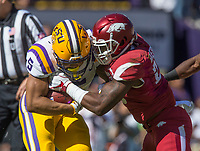 NWA Democrat-Gazette/BEN GOFF @NWABENGOFF<br /> Dre Greenlaw, Arkansas linebacker, tackles Derrius Guice, LSU running back, in the first quarter Saturday, Nov. 11, 2017 at Tiger Stadium in Baton Rouge, La.