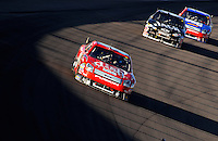 Mar 2, 2008; Las Vegas, NV, USA; NASCAR Sprint Cup Series driver Carl Edwards (99) leads Clint Bowyer and Matt Kenseth during the UAW Dodge 400 at Las Vegas Motor Speedway. Mandatory Credit: Mark J. Rebilas-US PRESSWIRE
