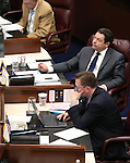 Nevada Senate Republicans, from top, Joe Hardy, Michael Roberson and Ben Kieckhefer work on the Senate floor at the Legislative Building in Carson City, Nev., on Friday, April 3, 2015. <br /> Photo by Cathleen Allison