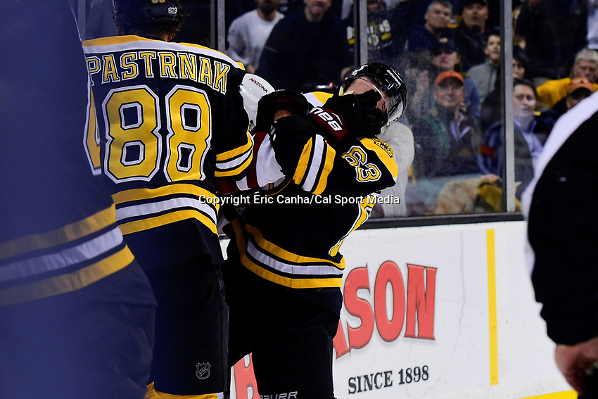 Tuesday, February 28, 2017: Arizona Coyotes defenseman Anthony DeAngelo (77) gets a hold of Boston Bruins left wing Brad Marchand (63) by the face during the National Hockey League game between the Arizona Coyotes and the Boston Bruins held at TD Garden, in Boston, Mass. Boston defeats Arizona 4-1. Eric Canha/CSM