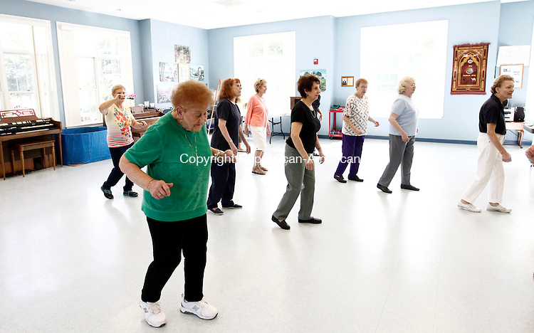 Wolcott, CT- 22 September 2014-092214CM01-  Lois Marticello, of Prospect, leads a group of women in line dancing during a dance class at the Rietdyke Senior Center in Wolcott on Monday.  Marticello, who is 88 years old, leads classes in Wolcott and in Prospect during the week.  She is assisted by  fellow dance instructor, Roberta Felesina.  For more information and to sign up for a class, please call Marticello at 203-233-1354.    Christopher Massa Republican-American