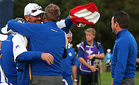 Thomas Bjorn (EUR) and Ian Poulter (EUR) embrace as the closing moments of the RC unfold during Sunday's Singles at the 2014 Ryder Cup from Gleneagles, Perthshire, Scotland. Picture:  David Lloyd / www.golffile.ie
