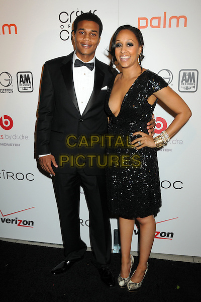 "COREY HARDRICT & TIA MOWRY .Interscope Geffen A&M Records 4th Annual ""Creme of the Crop"" Post BET Awards 2010 Celebration held at Mr. Chow Restaurant,  Beverly Hills, California, USA, 27th June 2010..full length hand on hi tuxedo tux husband wife couple married black v-neck low cut sequined sequin .CAP/ADM/BP.©Byron Purvis/AdMedia/Capital Pictures."