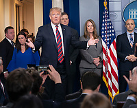 United States President Donald J. Trump enters the White House briefing room in Washington, DC, to maker a statement about border security, January 3, 2019. Standing with Trump are members of agencies associated with border security. Credit: Chris Kleponis / CNP/AdMedia