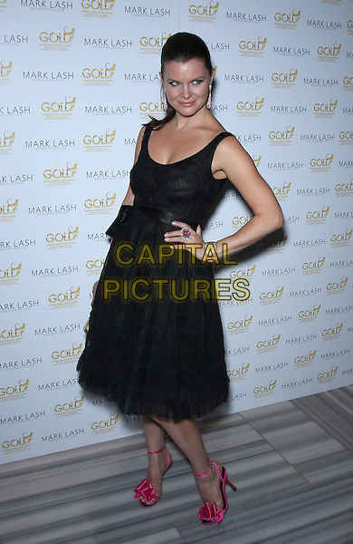 Heather Tom.Mark Lash 2011 Jewelry Showcase at Gold Nightclub inside Aria Hotel at CityCenter, Las Vegas, Nevada, USA..November 5th, 2011.full length black dress hand on hip red pink shoes.CAP/ADM/MJT.© MJT/AdMedia/Capital Pictures.