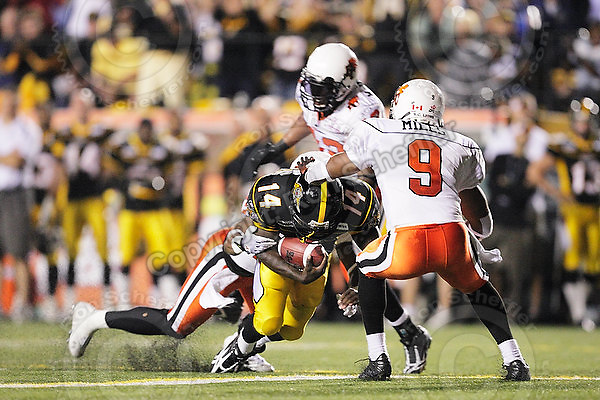 July 31, 2009; Hamilton, ON, CAN; Hamilton Tiger-Cats running back DeAndra' Cobb (14) scores a touchdown while tackled by BC Lions defensive back Ryan Phillips (21). CFL football: BC Lions vs. Hamilton Tiger-Cats at Ivor Wynne Stadium. The Tiger-Cats defeated the Lions 30-18. Mandatory Credit: Ron Scheffler. Copyright (c) 2009 Ron Scheffler.