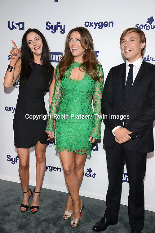Alexandra Park, Elizabeth Hurley and William Moseley  of &quot;The Royals&quot; attend the NBCUniversal Cable Entertainment Upfront <br /> on May 15, 2014 at The Javits Center North Hall in New York City, New York, USA.