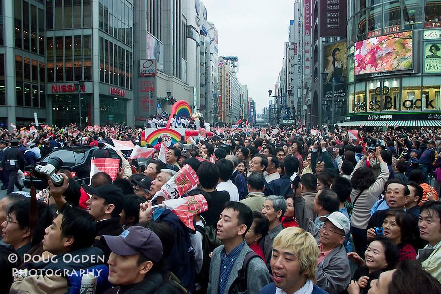 1 million people gather for  a parade down Chuodori Avenue, Ginza, for the Yojmiuri Giants Tokyo Japan