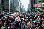 1 million people gather for  a parade down Chuodori Avenue, Ginza, for the Yojmiuri Giants Tokyo Japan